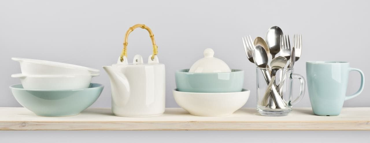 blue crockery white teapot and glass with cutlery